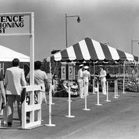 Guests arrive for the commissioning of the nuclear-powered attack submarine Providence (SSN-719) on July 27, 1985. (U.S. Navy photo by Joan Zopf, from the Department of Defense Still Media Collection)