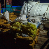 The guided-missile destroyer USS Chung-Hoon (DDG 93) seized 11,000 pounds of illicit drugs aboard a stateless vessel while conducting maritime security operations in the international waters of the Gulf of Aden. (Photo: U.S. Navy)