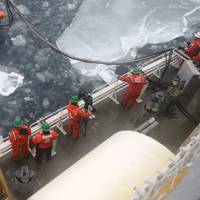 Helix Oil Skimmer being deployed off the USCGC HEALY.