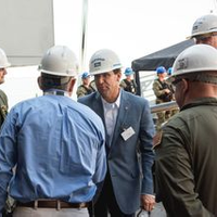 HII President and CEO Mike Petters (center) greets Secretary of Defense Mark Esper during his first visit to the company's Newport News Shipbuilding division and the aircraft carrier USS Gerald R. Ford (CVN 78). Photo by Matt Hildreth/HII