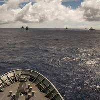 HMAS Success maintains her assigned station on the Guide during the Fleet Formation serial, in which 38 warships and four submarines sailed in close company, testing the seamanship skills of bridge watchkeeping staff. The serial took 11 hours and resulted in an arial photograph of all the participating RIMPAC 14 ships and submarines.