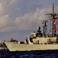 HMAS Warramunga conducts a twilight patrol around the natural gas production facility, Prod Bayu-Undan, as the ship and crew of HMAS Warramunga conduct a maritime security patrol in the Timor Sea as part of Ex Blue Raptor 2013. Photo: LSIS Brenton Freind