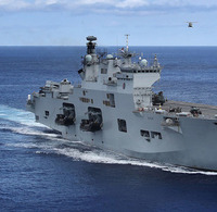 HMS Ocean heading for the Caribbean. Crown copyright.
