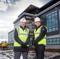 Howard Crawshaw, director of Knight Property Group, and Bibby Offshore's chief executive Howard Woodcock outside Bibby's new HQ in Westhill