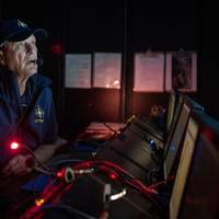 In 2019, Nautilus plied the Pacific waters off the island of Nikumaroro, searching for any sign of Amelia Earhart's lost plane. In the cool, dark control room, we kept a 24-hour vigil. (Gabriel Scarlett/National Geographic Image Collection)