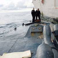 In this photo released by the U.S. Coast Guard, members of U.S. Coast Guard law enforcement detachment 404 survey the deck of the self-propelled, semi-submersible craft seized Saturday, Sept. 13, 2008, by the guided-missile frigate USS McInerney (FFG 8). The Coast Guard law enforcement officers, embarked aboard the McInerney, seized the estimated $187 million worth of cocaine during a night raid about 350 miles west of Guatemala.