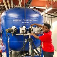 Irine Neba Neba Mforsoh performing an experiment in Professor Arun Shukla's Dynamic Photomechanics Laboratory at URI. (Photo courtesy of Irine Neba Neba Mforsoh)