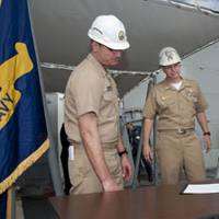 ith U.S. Navy Capt. Bill Galinis, supervisor of shipbuilding, Gulf Coast, far left and U.S. Navy Cmdr. Thomas R. Williams, DDG 110's prospective commanding officer, center, observing, George Nungesser, Northrop Grumman Shipbuilding program manager for the DDG 51 program, signs the DD250 form officially transferring custody of William P. Lawrence (DDG 110) from Northrop Grumman to the Navy. Photo courtesy Northrop Grumman.