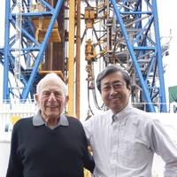 JAMSTEC President Asahiko Taira with Walter Munk on the deck of D/V Chikyu in front of the ship's drilling derrick. Credit: JAMSTEC