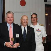 John Artzen, Chairman of the U.S. Merchant Marine Academy (USMMA) Alumni Association (far left), Rear Admiral Mark H. Buzby, USN, Ret., Maritime Administrator (third from left), and Rear Admiral James Helis, USMS, USMMA Superintendent (far right), present the Outstanding Professional Achievement Award to Robert Clyne, ABS Senior Vice President, General Counsel and Corporate Secretary. Photo: ABS