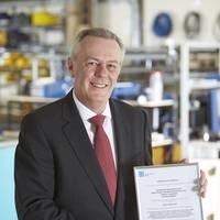 John Ramsden, Managing Director for Sonardyne, with Sonardyne Ltd.'s OHSAS 18001 certification