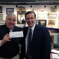 John S. Johnson, Treasurer of the National Coast Guard Museum Association Inc. celebrates the receipt of Eastern Shipbuilding's first donation with U.S. Senator Chris Murphy of Connecticut. (Photo courtesy of the National Coast Guard Museum Association)