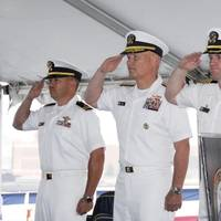 (Left to right) Navy Lt. Harlan Kimball, Comfort chaplain; Navy Rear Adm. Mark H. Buzby, commander, Military Sealift Command; Navy Capt. David K. Weiss, U.S. Navy Medical Corps; and Navy Capt. Kevin J. Knoop, commanding offer, Medical Treatment Facility, USNS Comfort, participate in Military Sealift Command hospital ship USNS Comfort's Medical Treatment Facility change of command ceremony May 25 in Baltimore.