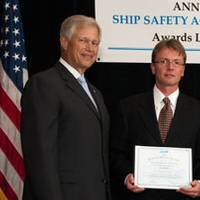 Leiv Lea, Director of Global Towing & Transportation, accepts the award on behalf of Foss (Photo courtesy Foss)