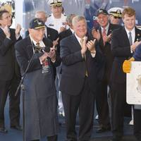 Leon Walston, a Newport News Shipbuilding welder from Massachusetts, displays the welded initials of Caroline Kennedy, the sponsor of the aircraft carrier John F. Kennedy (CVN 79). Also pictured (left to right) are Rear Adm. Earl Yates, the first commanding officer of the aircraft carrier USS John F. Kennedy (CV 67); Newport News Shipbuilding President Matt Mulherin; Virginia Gov. Terry McAuliffe; and Rep. Joseph Kennedy. (Photo by Chris Oxley/HII)