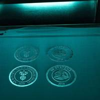 Logos from Newport News Shipbuilding and 3D Systems were fabricated during a demonstration of the new 3-D printer. (Photo by John Whalen/HII)