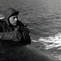 Lookout on the bridge of USS Nautilus (SSN 571) keeps an alert watch for pieces of ice as the Nautilus presses closer to the Polar Ice Cap, August 1958. (NHHC Photograph Collection, L-File, Ships)