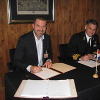 M C Jeronimus, Vice President of Goltens Europe, and Captain RNLN J F Kwak, Head Projects Procurement Division Ministry of Defense, sign the contract at The Hague (Photo: Goltens)