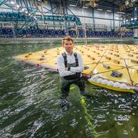 MARIN's Olaf Waals pictured with the scale model of a mega floating island in its Offshore Basin in a storm of waves, wind and currents. (Images: MARIN)