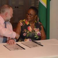 National Hydrographer of the UK Hydrographic Office, Rear Admiral Tim Lowe and Director General of the Maritime Administration Department, Claudette Rogers during the signing of the agreement. Photo: DPI Guyana