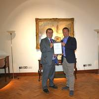 Nick Davis, CEO of GoAGT, receiving ISO/PAS 28007 certificate from David Derrick, LRQA's UK Business Centre Manager.