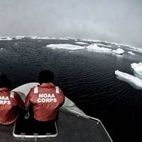 NOAA officers aboard one of the smaller survey vessels contemplate the vastness of the Chukchi Sea during the NOAA Ship Fairweather's reconnaissance survey in 2013. (Credit: NOAA)