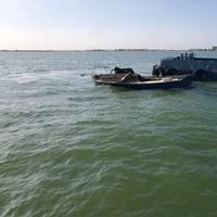 Offshore supply vessel Erin T alongside a fire-stricken boat near the Houston Ship Channel entrance in Galveston, Texas (Photo: U.S. Coast Guard)