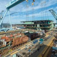 On January 17, Newport News shipbuilders lifted a 704-metric-ton unit into Dry Dock 12, where the aircraft carrier John F. Kennedy (CVN 79) is taking shape. (Photo by Chris Oxley/HII)