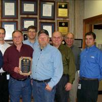 """On March 19, 2009, at the corporate office in Larose, representatives from the U.S. Department of the Interior's Minerals Management Service presented Danos & Curole with the Houma District SAFE Award. Pictured from left to right: Daryl Griffin (MMS Lead Inspector), Orvie """"Shag"""" Shannon (Production Operator), Paul Danos (VP Domestic Operations), Marvin Vining (Construction Inspector), Bryan Domangue (MMS Houma District Manager), Mark Hill (Production Operator), Manuel Merlos (Labor Services Mana"""