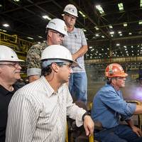 Paul Bosarge, a burner workleaderman at Ingalls Shipbuilding, starts fabrication of steel for the amphibious assault ship Bougainville (LHA 8). Also pictured (left to right) are Frank Jermyn, Ingalls' LHA 8 ship program manager; Lance Carnahan, Ingalls' steel fabrication director; U.S. Marine Corps Capt. J.D. Owens, representing Supervisor of Shipbuilding, Gulf Coast; and Ricky Hathorn, Ingalls' hull general superintendent. (Photo: Derek Fountain/HII)