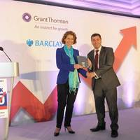 Peel Ports chief executive Mark Whitworth receiving the Sunday Times Grant Thornton Top Track 250 award from Grant Thornton UK chief executive Sacha Romanovitch