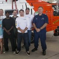 People rescued April 15 by the Coast Guard reunite with their rescuers at Air Station Clearwater, Fla., Thursday, April 27, 2017. (U.S. Coast Guard photo by Ashley J. Johnson)