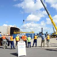 Personnel from the Coast Guard, Navy, state of Hawaii and key industries partners observe crane operations during the Hawaii Alternate Port Concept Full Scale Exercise at Joint Base Pearl Harbor-Hickam. (U.S. Coast Guard photo by Tara Molle)
