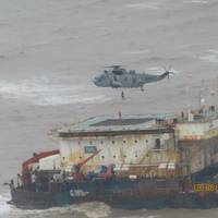 Photo shows rescue operation on another barge off India battered by the storm - Credit: Press Iinformation Bureau Maharashtra