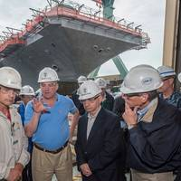 Pictured with U.S. Sens. Tim Kaine and Jack Reed  in front of USS Abraham Lincoln are (left to right) Capt. Karl Thomas, the ship's commanding officer; Todd West, director, Newport News' RCOH program; and Chris Miner, Newport News' vice president of in-service aircraft carrier programs. Photo by Chris Oxley, Huntington Ingalls Industries