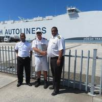 Port of Durban marine pilot Rainer Rauntenberg (center) with Port of Durban Harbor Master Captain Alex Miya (left) and Deputy Harbor Master Captain Justin Adams (right). (Photo: Transnet National Ports Authority)