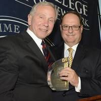President and CEO of Bouchard Transportation, Morton S. Bouchard III accepts the Admiral's Award from Maritime College Interim President Dr. Michael A. Cappeto at the Annual Admiral's Scholarship Dinner on Tuesday, May 6, 2014