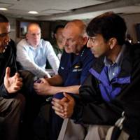 President Obama talks with Coast Guard Admiral Thad Allen, who was also the National Incident Commander for the Deepwater Horizon oil spill (center), and Louisiana Gov. Bobby Jindal aboard Marine One as they fly along the coastline from Venice, La., to New Orleans on May 2, 2010. White House Photo by Pete Souza