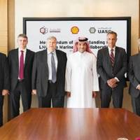 Qatargas CEO Khalid bin Khalifa Al Thani (fifth left), United Arab Shipping Company CEO Jorn Hinge (fourth left), and Managing Director and Chairman of Qatar Shell Companies, Michiel Kool (sixth left) along with other officials after the signing ceremony. Photo: Qatargas