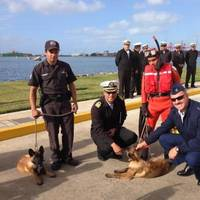 Rear Adm. Karl Schultz, commander of the 11th Coast Guard District, visits the Mexican Navy Second Naval Region's K-9 unit where handlers demonstrated how the dogs carry out contraband detection Thursday, Dec. 5, 2013, in Ensenada, Mexico. The trip was in part of a joint two-day search and rescue exercise with members of the Mexican Navy. U.S. Coast Guard photo.