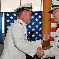 Rear Adm. T. K. Shannon (left) and Rear Adm. Mark Buzby congratulate each other during a change of command ceremony aboard the USNS Spearhead (JSHV 1). Shannon relieved Buzby as commander, Military Sealift Command.  (U.S. Navy Photo by Mass Communication Specialist Seaman Apprentice Jesse A. Hyatt)