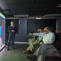 Rep. Conaway points at a simulated engine room during a demonstration of the Rapid Operational Virtual Reality tool that enables Newport News Shipbuilding construction teams to collaborate, consider improvements and trouble-shoot onsite during aircraft carrier construction. (Photo by Chris Oxley/HII)
