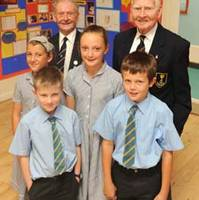 Residents from the Royal Alfred Seafarers' Society Geoffrey Talbot and Roy Ticehurst [L-R] with pupils from St Anne's Primary School in Banstead Emma Prichard, Rowan Stott, Katie Costello and Niall Cogavin [L-R]