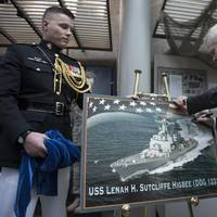 Secretary of the Navy Ray Mabus signs a graphic representation of the future guided-missile destroyer USS Lenah H. Sutcliffe Higbee (DDG 123) at the Women in Military Service for America Memorial. (U.S. Navy photo by Armando Gonzales)