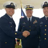Senior Chief Petty Officer Eric Best (left) assumed command of Coast Guard Station Montauk from Senior Chief Petty Officer Jason Walter (right) during a change of command and retirement ceremony held in Montauk. Capt. Edward J. Cubanski (middle), commander of Coast Guard Sector Long Island Sound, presided over the ceremony. (USCG photo by Ali Flockerzi)