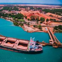 Ship being loaded at Rio Tinto Weipa operations with bauxite stockpiles in the background. Copyright © 2018 Rio Tinto.