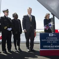 Ship Sponsor Georgeann McRaven christens DDG 114, the destroyer named for Medal of Honor recipient Ralph Johnson. Also pictured (left to right) are Assistant Secretary of the Navy Sean Stackley; Cmdr. Jason Patterson, the ship's prospective commanding officer; Helen Richards, Ralph Johnson's sister; and Ingalls Shipbuilding President Brian Cuccias. (Photo by HII)