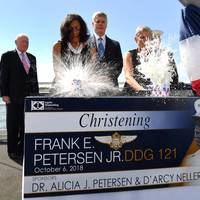 Ship Sponsors Alicia J. Petersen (left) and D'Arcy Neller (right) christen DDG 121, the destroyer named for Petersen's late husband, Frank E. Petersen Jr. Also pictured (left to right) are retired Gen. Alfred Gray, former commandant of the Marine Corps and keynote speaker at the christening; Ingalls Shipbuilding President Brian Cuccias; and Gen. Robert Neller, the 37th commandant of the Marine Corps. (Photo by Derek Fountain/HII)