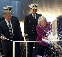 Ship's Sponsor Ellen Roughead performs the traditional honor of breaking a bottle of American sparkling wine across the hull of the submarine Minnesota (SSN 783). Also pictured (left to right) are Newport News Shipbuilding President Matt Mulherin and Cmdr. John Fancher, the ship's prospective commanding officer.