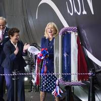 Ship's sponsor Jill Biden reacts after christening the submarine Delaware (SSN 791). Also pictured (left to right) are Cmdr. Brian Hogan, the submarine's commanding oficer; Sen. Thomas Carper, D-Del.; and Newport News Shipbuilding President Jennifer Boykin. Photo by John Whalen/Huntington Ingalls Industries